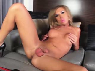 Lady-boy jerks off her big stick