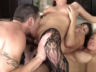 Three wild cougars getting banged by one young cock