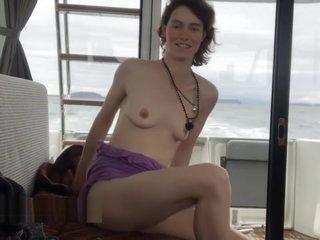 Topless MILF ocean boating tasting herself